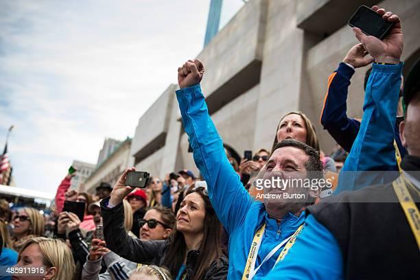 People cheer as Meb Keflezighi an American wins the Boston Marathon on April 21 2014 in Boston Massachusetts Today marks the 118th Boston Marathon...