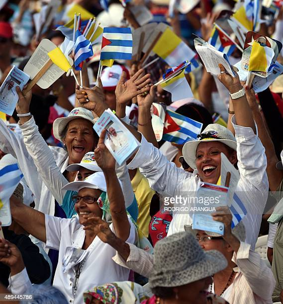 People cheer as Pope Francis arrives to give a morning mass at the Calixto Garcia square in Holguin in eastern Cuba on September 21 2015 Holguin a...