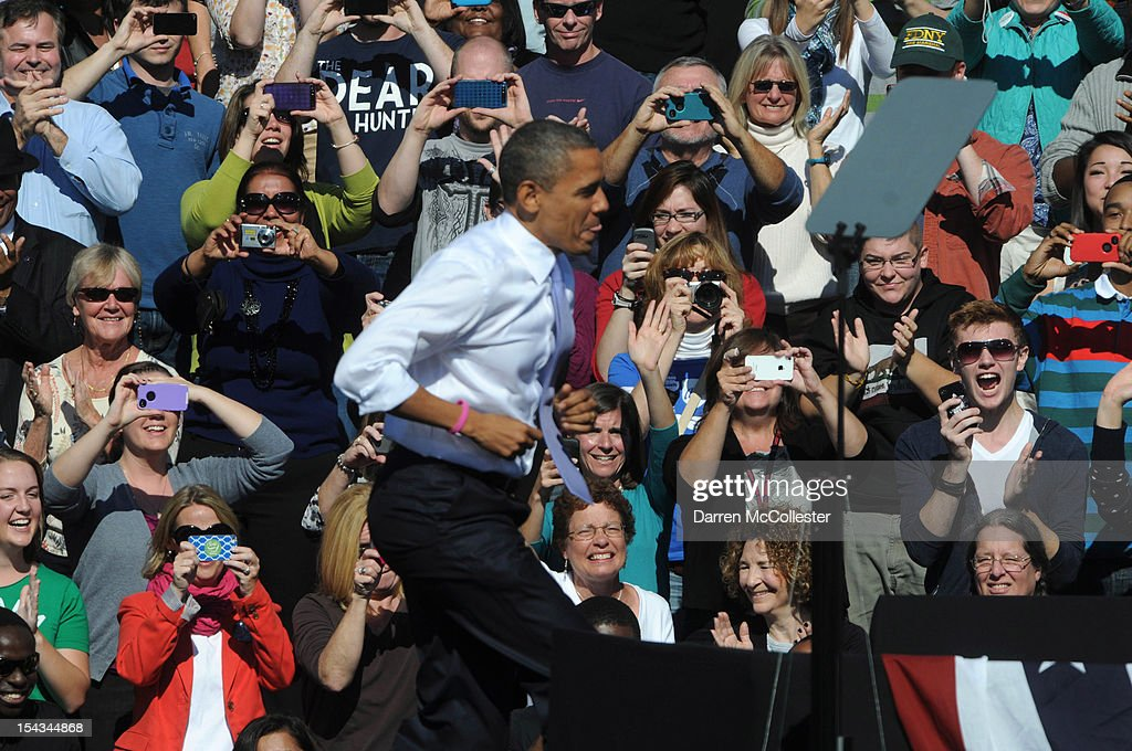 People cheer as President <a gi-track='captionPersonalityLinkClicked' href=/galleries/search?phrase=Barack+Obama&family=editorial&specificpeople=203260 ng-click='$event.stopPropagation()'>Barack Obama</a> takes the stage at an event at Veteran's Memorial Park October 18, 2012 in Manchester, New Hampshire. President Obama continues to campaign in swing states with just under three weeks left till Election Day.