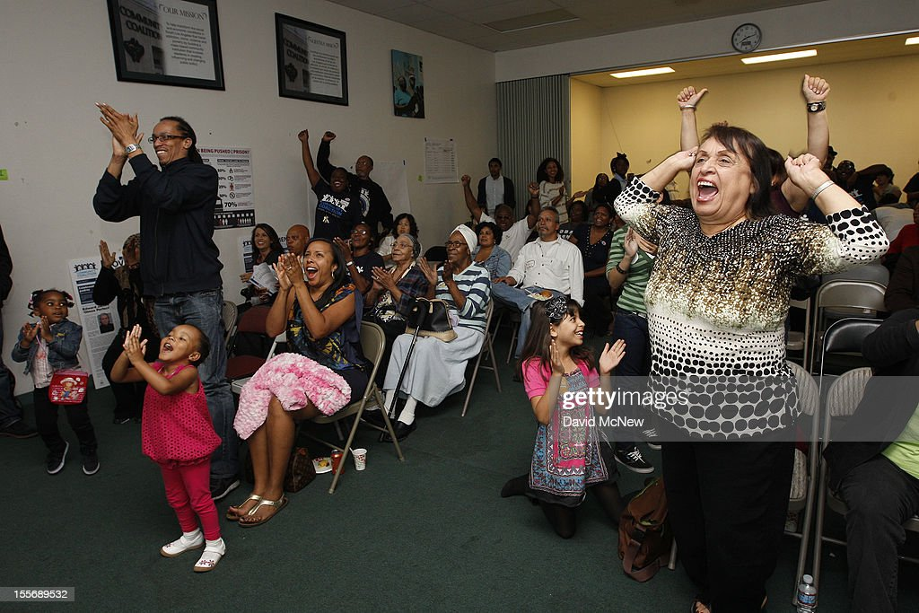 People cheer as television news reporters call a victory for President Barack Obama at the Community Coalition election night party during the U.S. presidential election on November 6, 2012 in the South Los Angeles section of Los Angeles, California. The Community Coalition was founded by U.S. Congresswoman Karen Bass in 1990 to help South L.A. communities that had been devastated by the 1980s crack cocaine epidemic. Voters went to polls in the heavily contested presidential race between incumbent U.S. President Barack Obama and Republican challenger Mitt Romney.