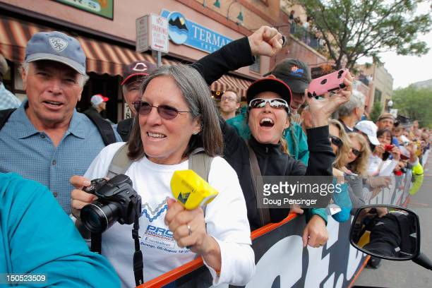 People cheer as the peloton leaves the start of stage one of the USA Pro Challenge from Durango to Telluride on August 20 2012 in Durango Colorado