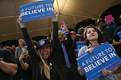 People cheer as they listen to Democratic presidential candidate Sen Bernie Sanders speak during a Future to Believe in concert and rally at the...