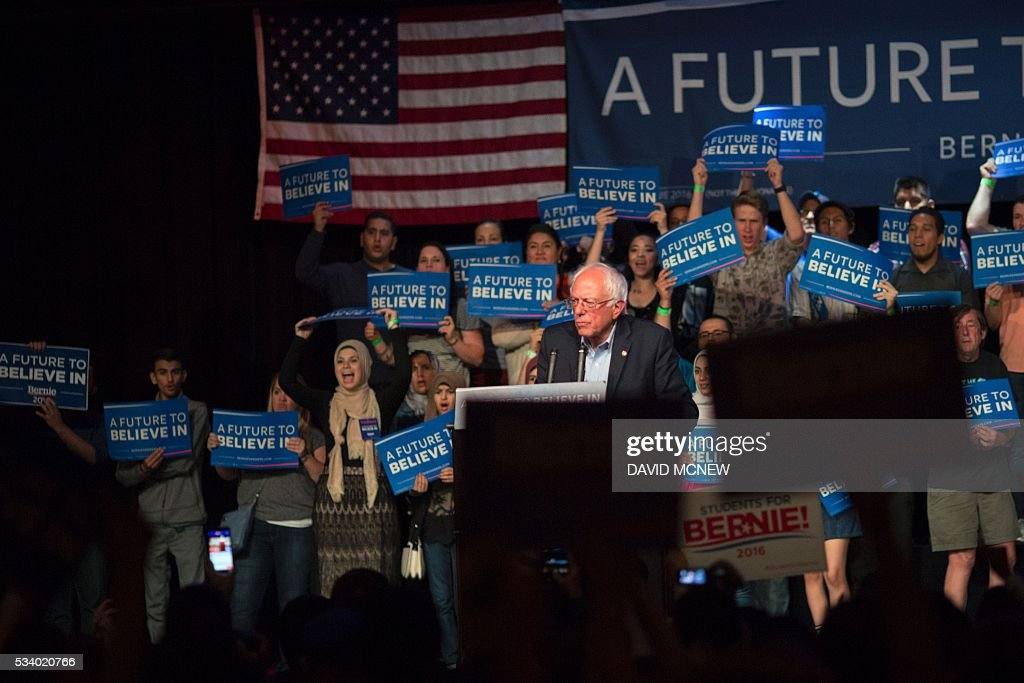 People cheer Democratic presidential candidate Bernie Sanders during a campaign rally at the Riverside Municipal Auditorium on May 24, 2016 in Riverside, California. US presidential candidates have turned their attention to campaigning in earnest for the June 7th California primary election. / AFP / DAVID