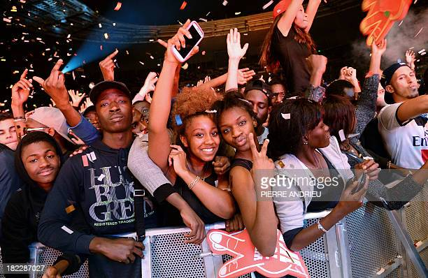 People cheer during the Urban Peace 3 hiphop concert on September 28 2013 at the Stade de France in SaintDenis near Paris AFP PHOTO / PIERRE ANDRIEU
