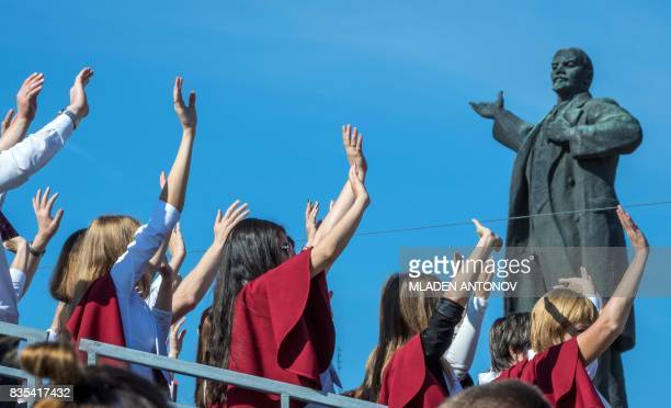 People cheer in front of a statue of Vladimir Lenin on August 19 2017 in Yekaterinburg during celebrations for the 294th anniversary of the city...