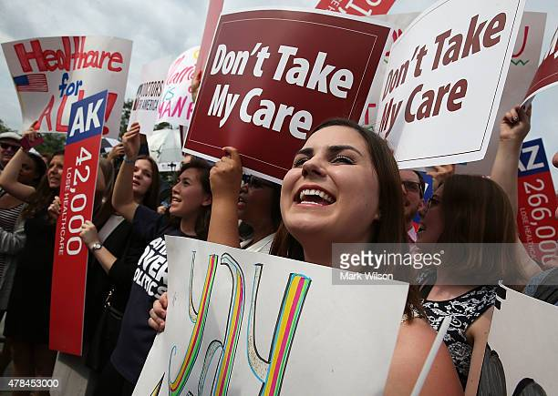 People cheer in front of the US Supreme Court after ruling was announced on the Affordable Care Act June 25 2015 in Washington DC The high court...