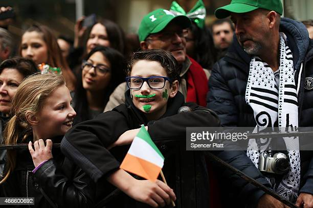 People cheer marchers as they make their way up 5th Avenue during New York City's St Patrick's Day Parade on March 17 2015 in New York City Despite a...
