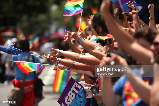 People cheer marchers during the annual New York City Gay Pride March on June 28 2009 in New York City This year�s march commemorates the 40th...