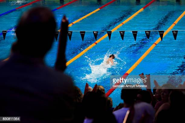 People cheer Mireia Belmonte as she competes during the Women's 400m Individual Medley Final of the FINA/airweave Swimming World Cup Eindhoven 2017...