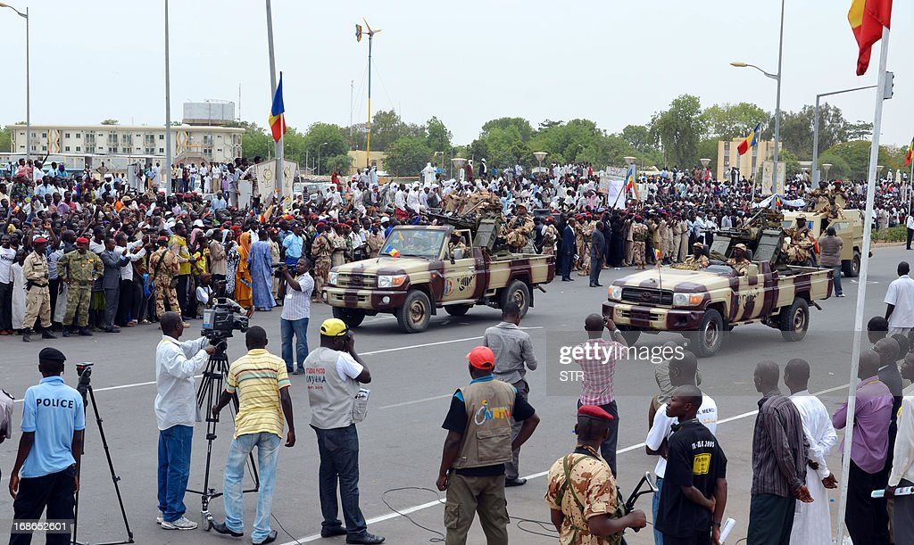People cheer on Chadian soldiers who returned home after a deployment in Mali during a procession through the capital N'Djamena on May 13 2013 Some...