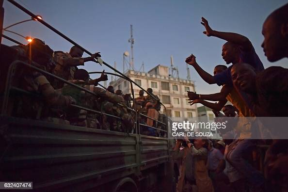 TOPSHOT People cheer Senegalese ECOWAS soldiers as they arrive at the Statehouse in Banjul on January 22 2017 West African troops approached the...