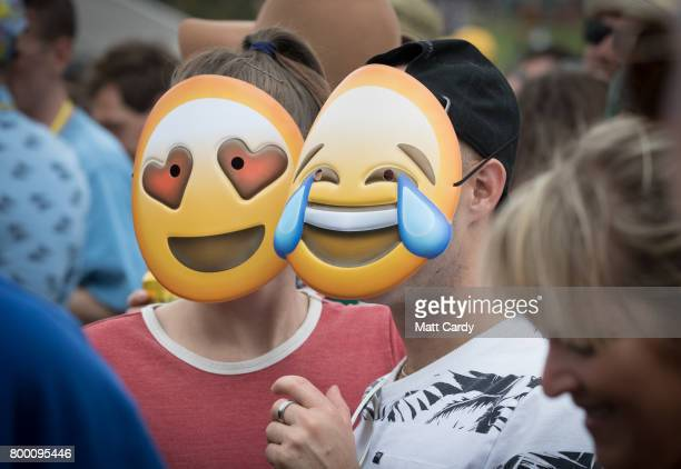 People cheer the opening act Hacienda Orchestra on the Pyramid Stage at the Glastonbury Festival site at Worthy Farm in Pilton on June 23 2017 near...