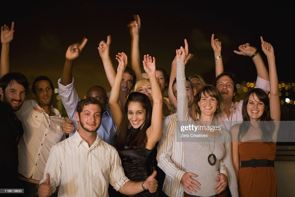People cheering at party at night : Stock Photo