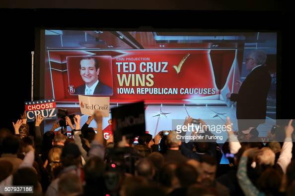 People cheers as Republican presidential candidate Sen Ted Cruz is declared the winner at the caucus night gathering at the Iowa State Fairgrounds on...