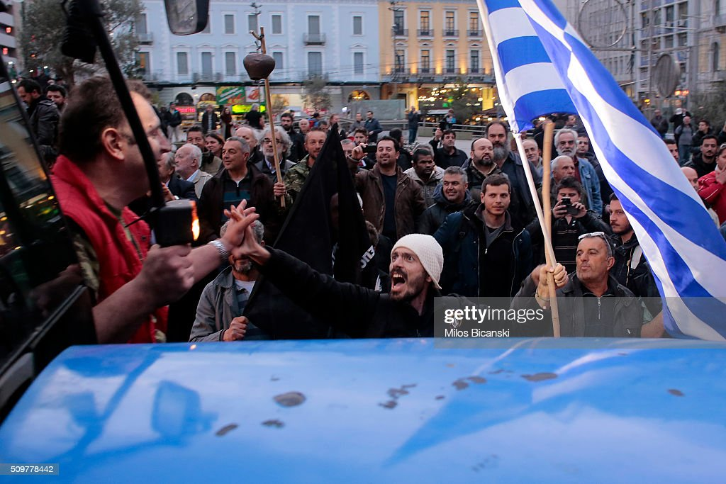 People cheers farmers arrivals with tractors in centre of town on February 12, 2016 in Athens, Greece. Farmers from across Greece gather in Athens for a two-day protest against the government and its plans to impose new tax hikes and pension charges.