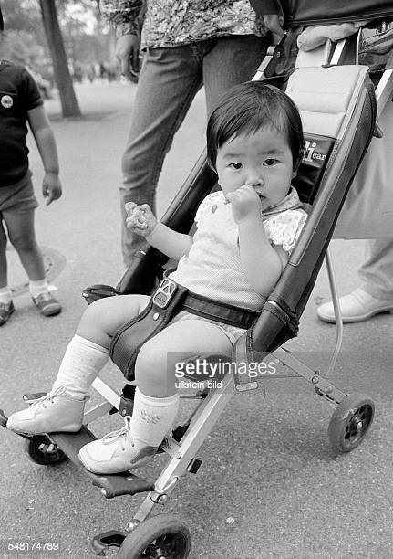 people children little boy in a baby carriage Japanese aged 2 to 3 years