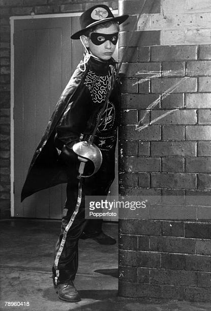 1958 London A boy dressed as 'Zorro' with mask hat and sabre