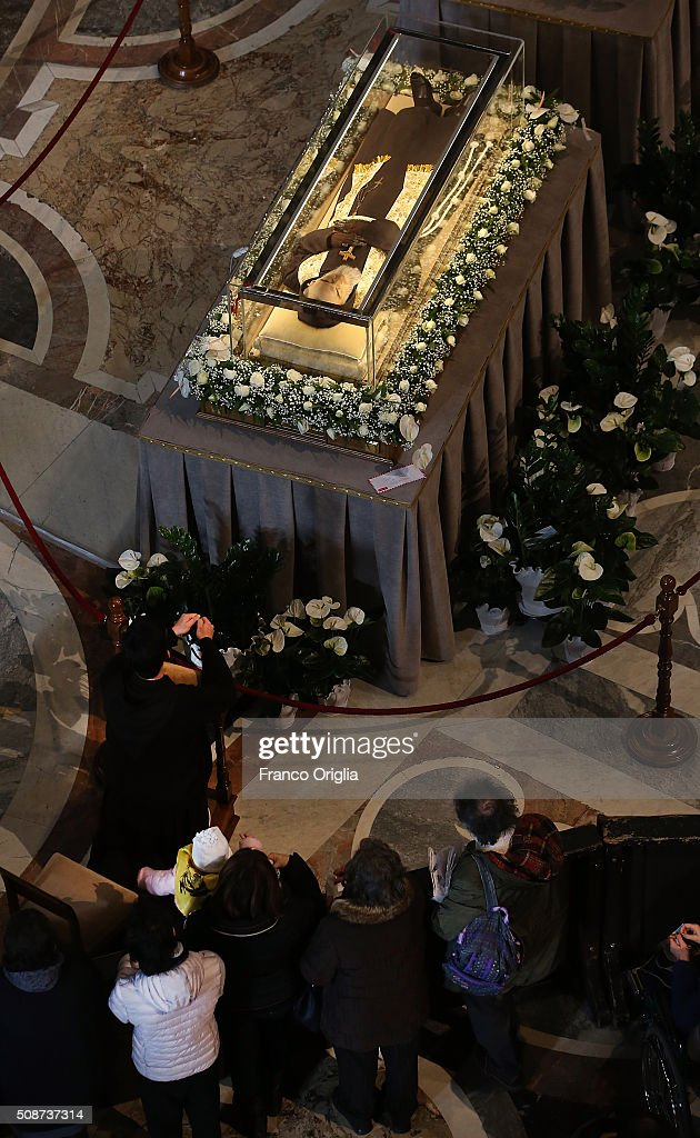 People circle around the corpse and relics of Padre Pio on display in St. Peter's Basilica for veneration by the faithful in connection with the ongoing Extraordinary Jubilee Year of Mercy on February 6, 2016 in Vatican City, Vatican. St. Pius of Pietralcina or San Padre Pio, as he is popularly known around the world was a Capuchin friar with a worldwide reputation during his earthly life as a mystic and miracle-worker, who was also a tireless confessor and laborer in favor of the poor, the sick, and the downtrodden.