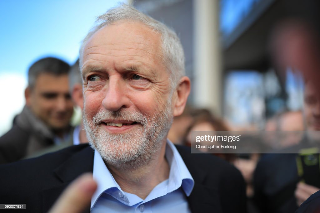 People clamour to shake hands and take selfies with Labour Leader Jeremy Corbyn after a rally at Southwater Library on June 6, 2017 in Telford, United Kingdom. Political parties continue to campaign across the country ahead of the general election on Thursday.