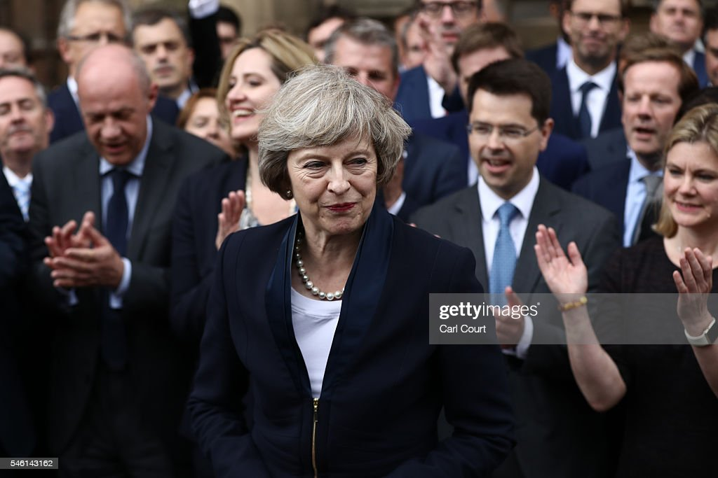 People clap as British Home Secretary Theresa May makes a statement after Andrea Leadsom pulled out of the contest earlier today to become Conservative Party leader outside the Houses of Parliament on July 11, 2016 in London, England. Theresa May will become the UK's new Prime Minister on Wednesday evening after David Cameron holds his final PMQs and visits the Queen to officially resign his position.