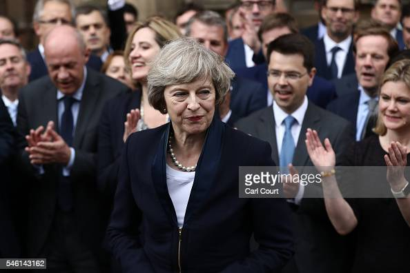 People clap as British Home Secretary Theresa May makes a statement after Andrea Leadsom pulled out of the contest earlier today to become...