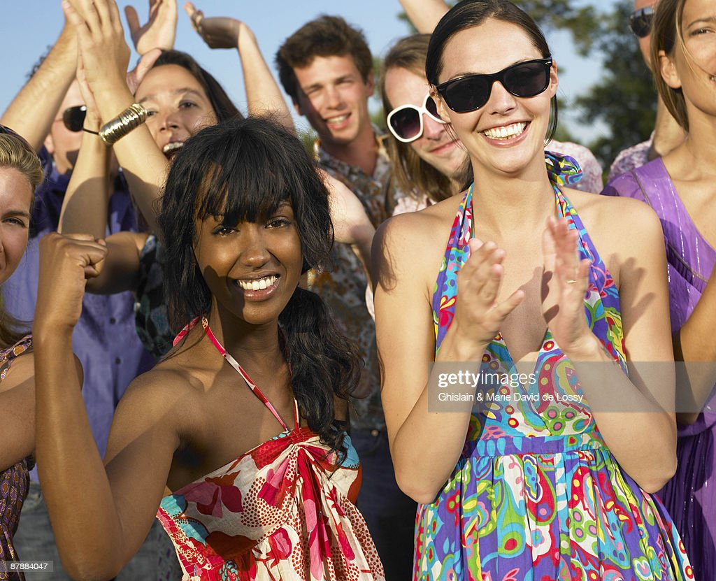 People clapping hands and smiling : Stock Photo