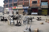 People clash with Indian police after the intervention of the police by using tear gas to disperse protesters in Srinagar the summer capital of...