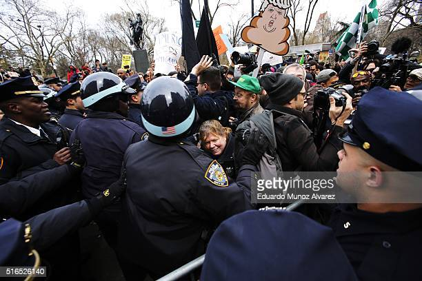 People clash with NYPD officers while they take part in a protest against Republican presidential candidate Donald Trump on March 19 2016 in New York...
