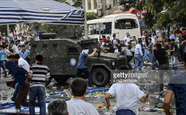 People clash with Turkish police after an explosion which injured several people during a rally by the proKurdish People's Democratic Party on June 5...