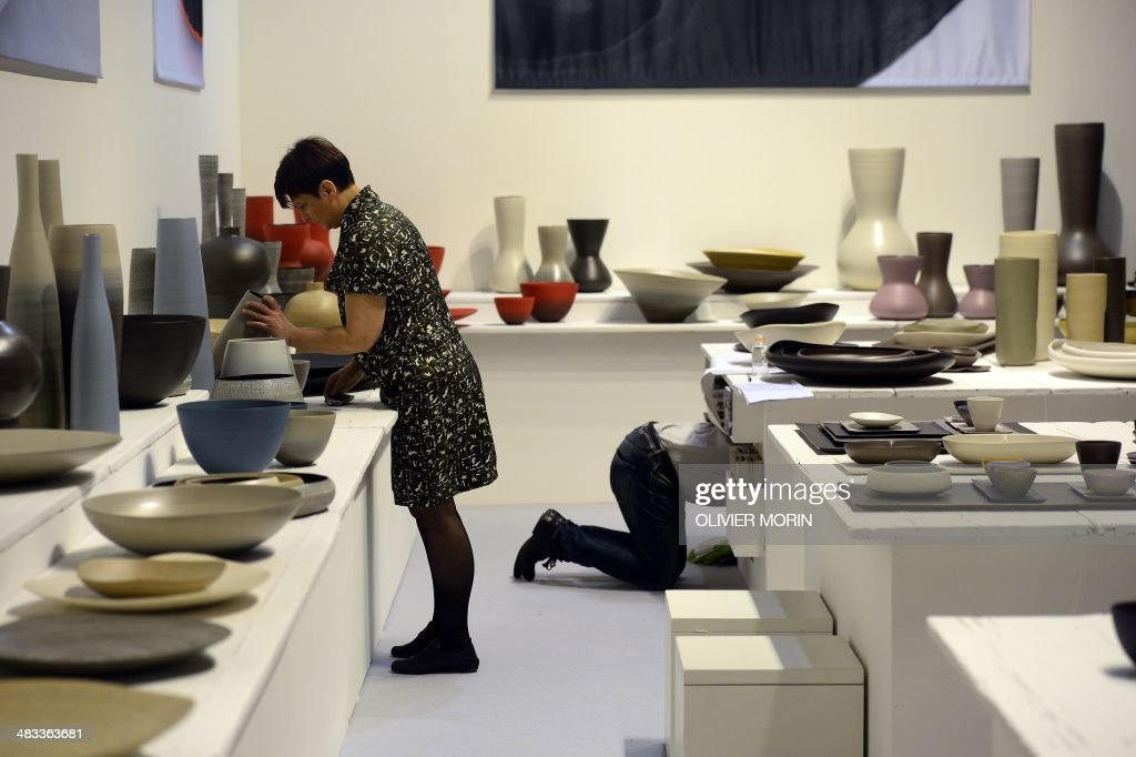 People clean their stand on April 8, 2014 during Milan's annual furniture fair at the Fiera Milano in Rho. The 'Salone Internazionale del Mobile' -- the biggest event in the design calender -- takes place from April 8 to 13. AFP PHOTO / OLIVIER MORIN