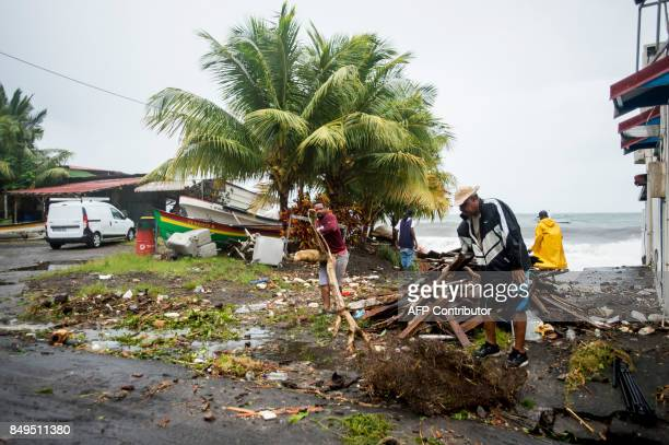 People clear debris in SaintPierre on the French Caribbean island of Martinique after it was hit by Hurricane Maria on September 19 2017 Martinique...