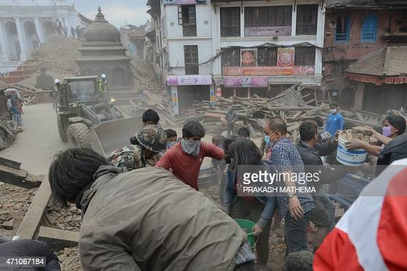 People clear rubble in Kathmandu's Durbar Square a UNESCO World Heritage Site that was severely damaged by an earthquake on April 25 2015 A massive...
