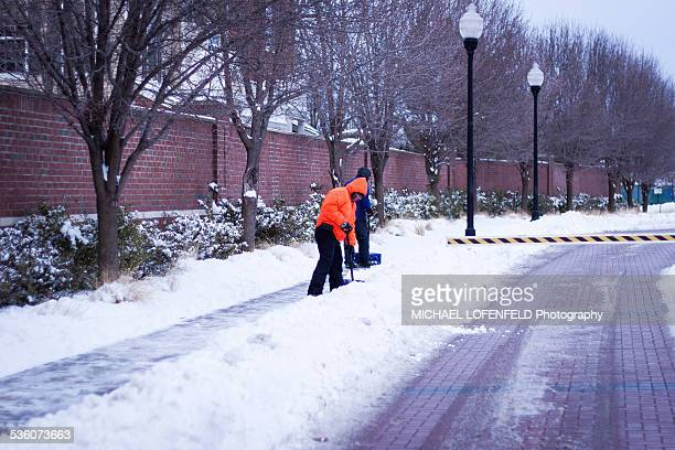 People clearing roads in Jersey City NJ After Winter Blizzard Juno on January 27 2015