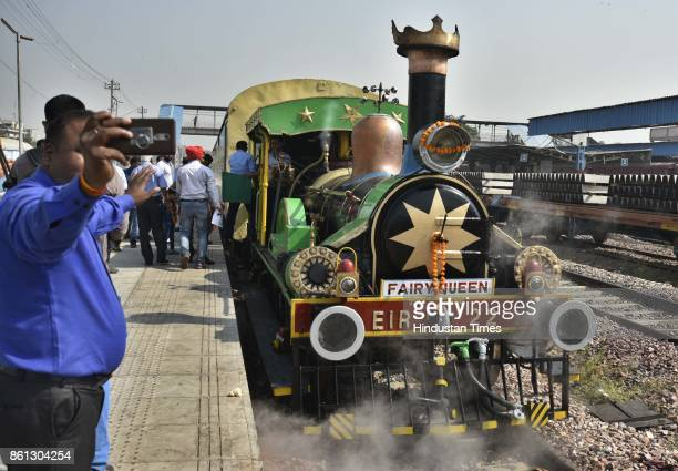 People click selfie with Fairy Queen 'The Steam Express' as it departs from Delhi Cantonment on October 14 2017 in New Delhi India The 162 year old...
