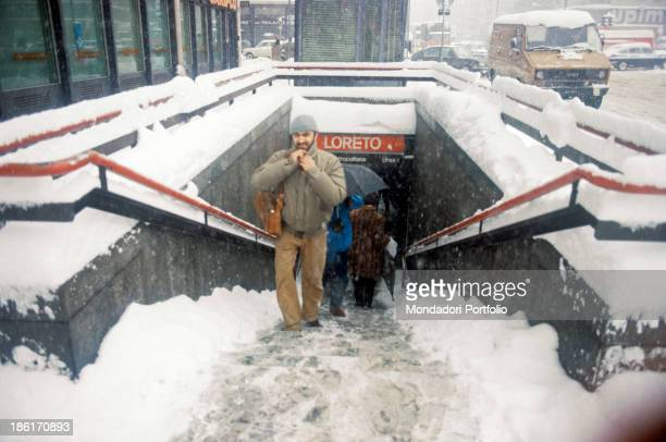 People climbing the stairs of the underground station in Loreto square One hundred and forty million cubic meters of snow fell in the city between...