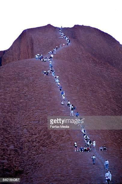 People climbing up Uluru Ayres Rock