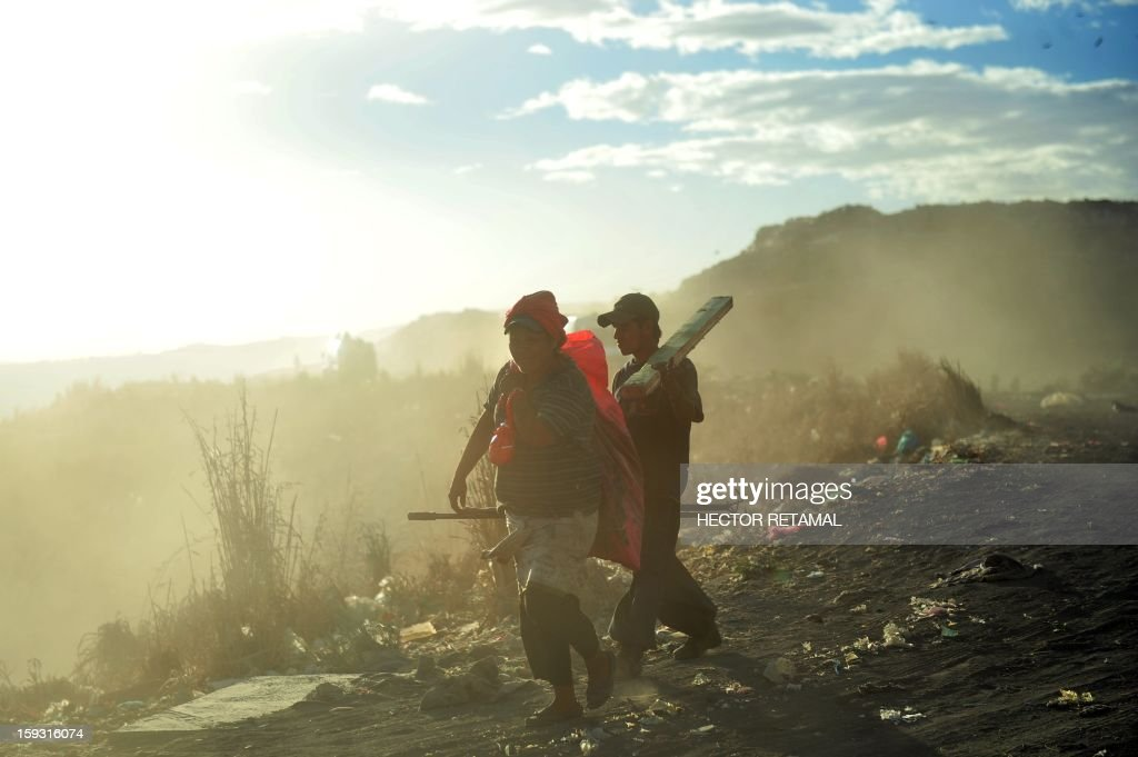 People collect plastic to be sold for recycling, at Managua's landfill 'La Chureca', on January 10, 2013. AFP PHOTO/Hector RETAMAL