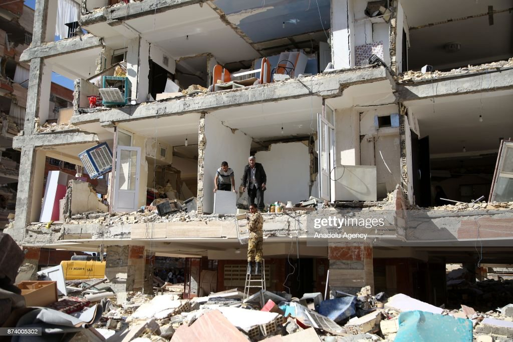 People collect their usable goods and belongings in their heavily damaged buildings in Sarpol-e Zahab town of Kermanshah, Iran on November 14, 2017 following a 7.3 magnitude earthquake that hit the Iraq and Iran. An earthquake measuring 7.3 on the Richter scale rocked northern Iraq and Iran, the U.S. Geological Survey said on Sunday evening. At least 400 died and above 7,000 others were injured in Iran's bordering regions, especially in Kermanshah province in west.