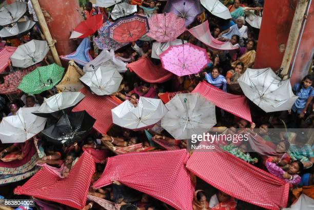 People collecting holy rice during the Annakut Utsav at Madan Mohon Mandir on October 20 2017 in Kolkata India Govardhan Puja also called Annakut is...