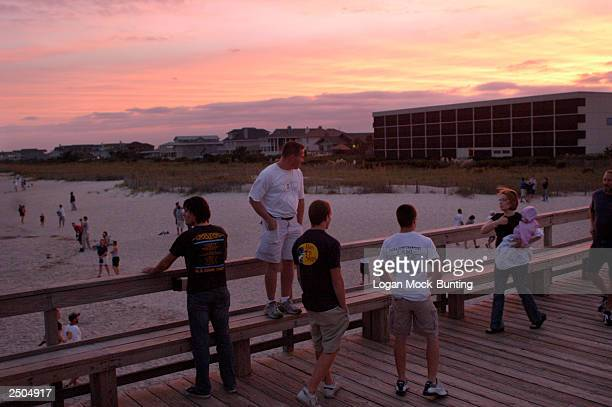 People come out to watch the churning surf September 17 2003 in Beaufort North Carolina Though many homeowners and businesses have evacuated as...