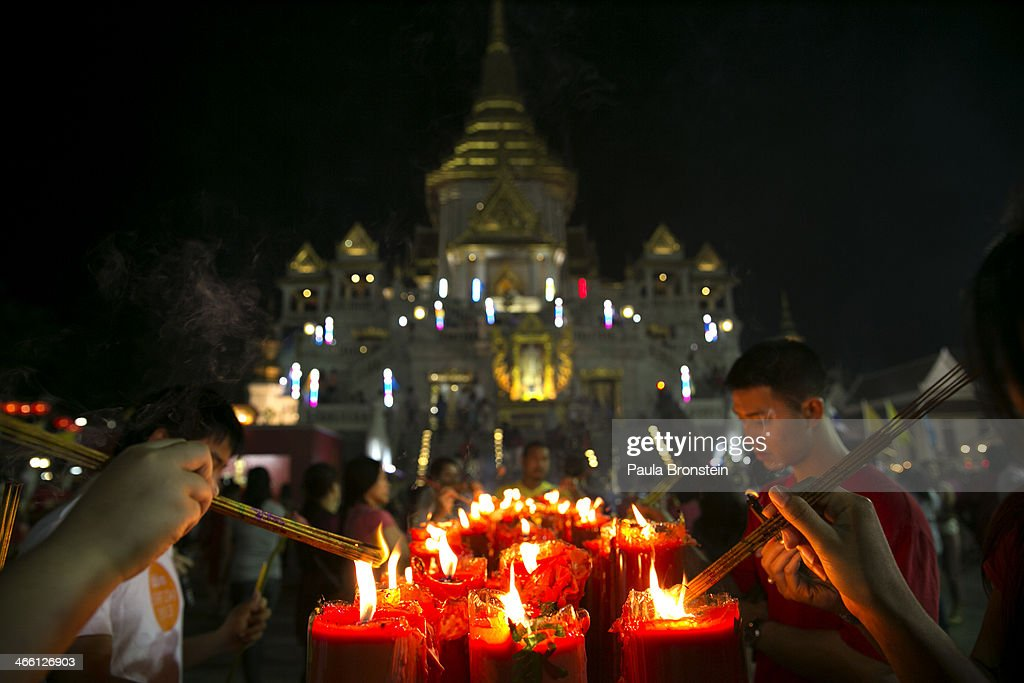 People come to burn incense offering prayers on Chinese New year at a temple on January 31, 2014 in Bangkok, Thailand. The general elections on February 2nd will take place as the anti-government protesters vow to cause disruptions by blocking polling stations in the capitol. Bangkok Shutdown has been in effect for over two weeks as the anti-government protesters continue to block major intersections. The Thai government imposed a 60-day state of emergency in Bangkok and the surrounding provinces in an attempt to cope with the on-going political turmoil, however this decree has had no effect on the mass protests.