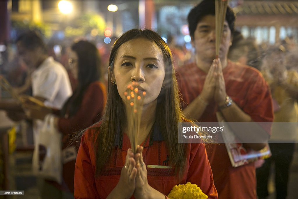 People come to offer prayers on Chinese New year at a temple on January 31, 2014 in Bangkok, Thailand. The general elections on February 2nd will take place as the anti-government protesters vow to cause disruptions by blocking polling stations in the capitol. Bangkok Shutdown has been in effect for over two weeks as the anti-government protesters continue to block major intersections. The Thai government imposed a 60-day state of emergency in Bangkok and the surrounding provinces in an attempt to cope with the on-going political turmoil, however this decree has had no effect on the mass protests.