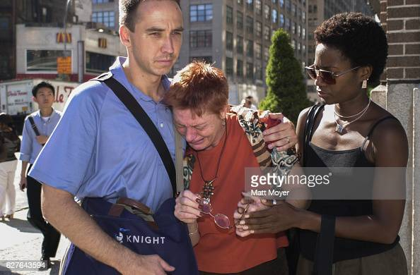 People comfort one another during the terrorist attack on The World Trade Center on Sept 11 2001