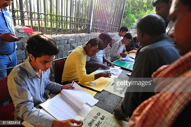 People coming early morning at a polling booth to cast their vote for general election of the 16th Lok Sabha 2014 on April 10 2014 in New Delhi India