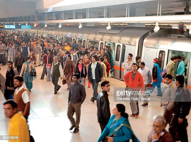 People coming out from Metro Train at Connaught Place Metro Station New Delhi India