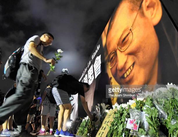 People commemorate late Nobel Prize laureate Liu Ziaobo on July 19 2017 in Hong Kong
