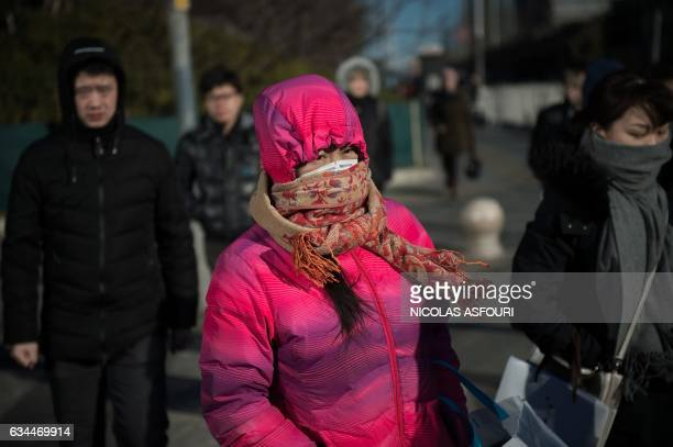 TOPSHOT People commute in the financial district in Beijing on February 10 2017 China's exports soared a forecastbeating 79 percent in January...