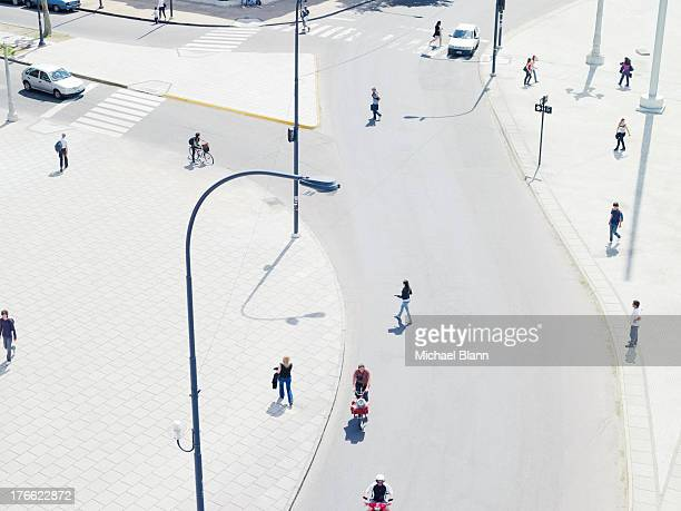 people commuting in the city from above, aerial