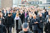 Business people commuting. Large sea of humanity. Commuters on London Bridge.