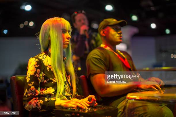 People compete at Ultra Street Fighter II The Final Challengers on opening day of the Electronic Entertainment Expo at the Los Angeles Convention...